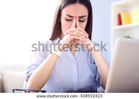 Cheerless sick woman sitting at the table