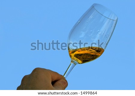 cheers ! A glass of Pacherenc du Vic-Bilh. So typically french ! - stock photo