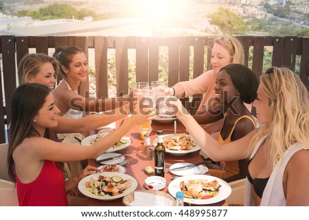 Cheers at dinner with friends