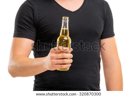 Cheers! Close up of male hand holding bottle of beer. Isolated on white. - stock photo