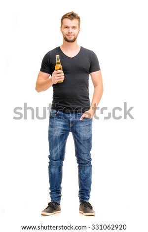 Cheers! Full length studio portrait of handsome young man holding the bottle of beer. Isolated on white. - stock photo