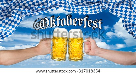 cheers! hands holding up german beer mugs under bavarian flag - stock photo