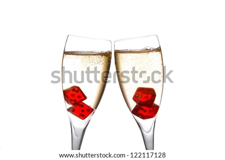 cheers, red dice in two champagne flutes with gold bubbles on white background - stock photo