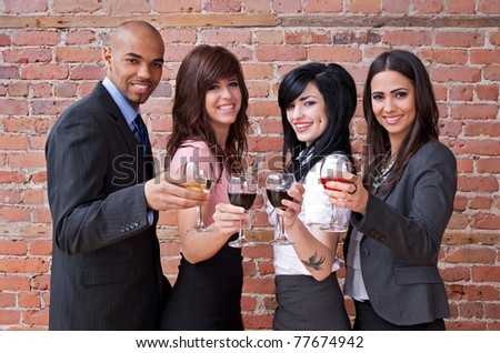 Cheers! Smiling young people with glasses of wine, having fun. - stock photo