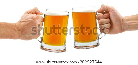 cheers, two glass beer mugs isolated on white - stock photo