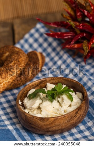 cheese and bagel on table - stock photo
