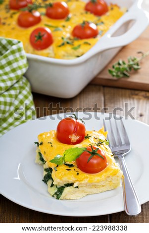 Cheese and bread breakfast bake with cherry tomatoes - stock photo