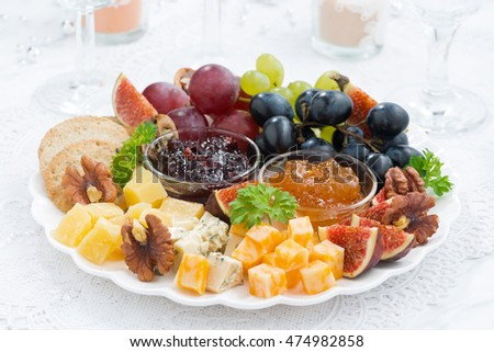 cheese and fruit plate to the holiday, closeup