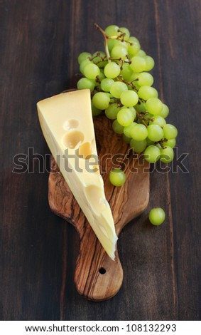 Cheese and grape on the wooden board
