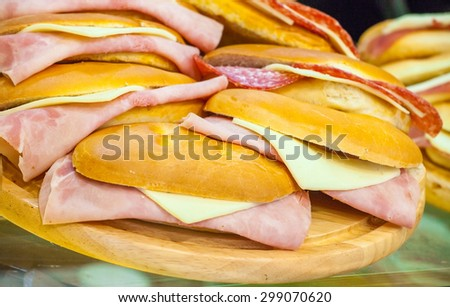 Cheese and ham sandwiches on a show-window of shop - stock photo