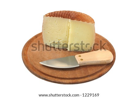 Cheese and knife - stock photo