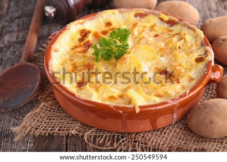 cheese and potato gratin - stock photo