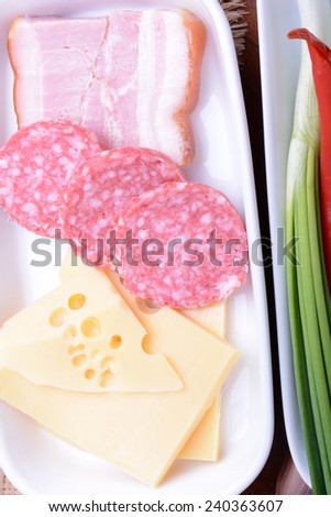 cheese and sausages with red pepper