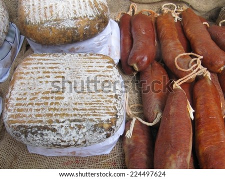 Cheese and sobrassada typical of Mallorca, Spain. - stock photo