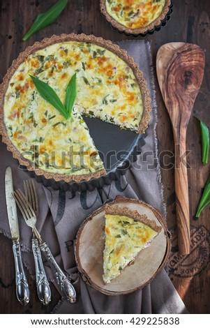 Cheese and wild garlic tart - stock photo