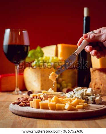 Cheese and wine on a dark table. Beautiful background