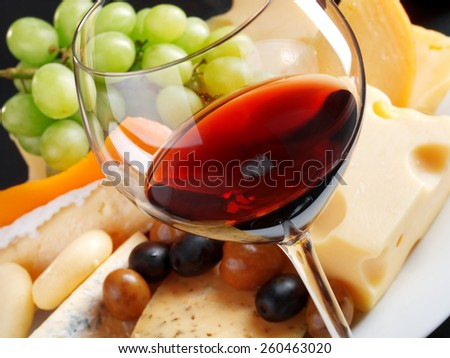 Cheese and wine still life - stock photo