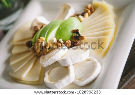 cheese assortment with nuts in a plate  - wedding decor