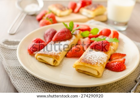 Cheese Blintzes - filled pancakes riccota and creame fresh with fresh fruit and mint - stock photo