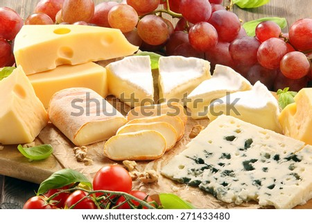 Cheese board - various types of cheese composition  - stock photo