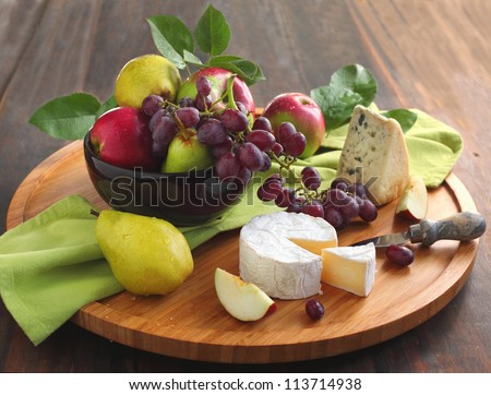Cheese board with fruits - stock photo