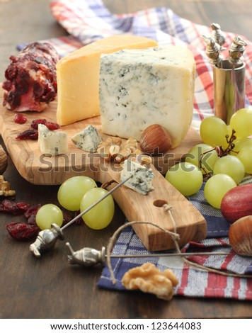 Cheese board with grape and nuts