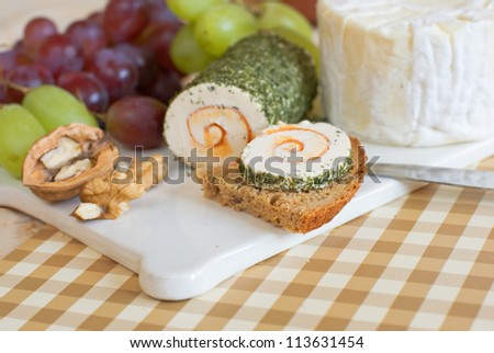 Cheese board with grapes and walnut - stock photo