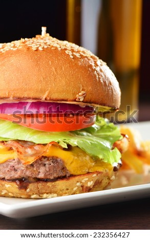 Cheese burger with a bacon - American cheese burger with fresh salad and french fries
