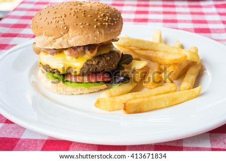 Cheese burger with a bacon and french fries - stock photo