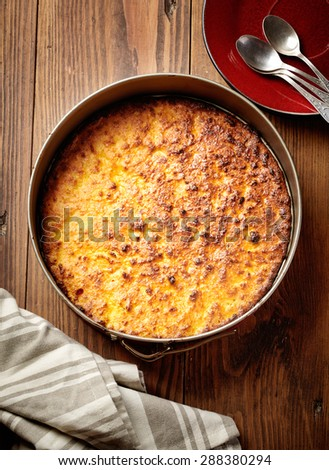 cheese cake in a baking tin - stock photo