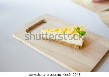 Cheese cake lemon on wood plate