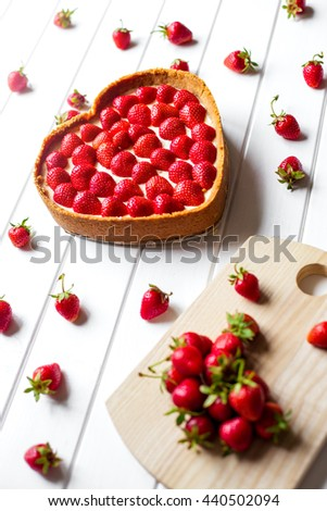 Cheese cake with fresh berries on wooden table. Selective focus - stock photo