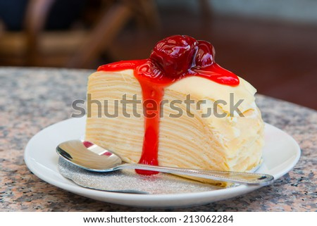 cheese cake with strawberry on dish - stock photo