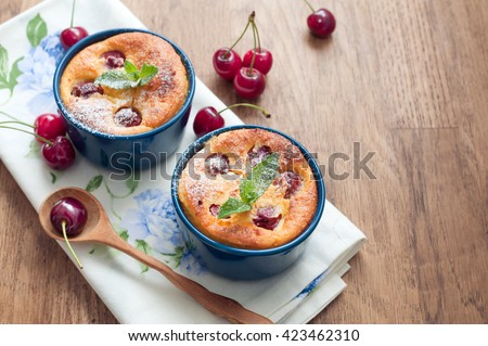Cheese casserole with cherries on wooden background - stock photo
