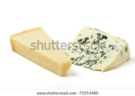 Cheese contrast of Hard parmesan cheese and Soft blue cheese. - stock photo