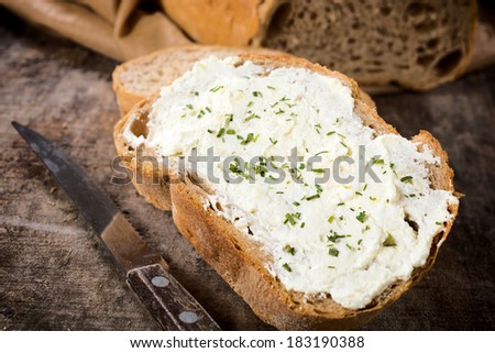 Cheese cream on the slice of bread.Selective focus on the front slice of bread  - stock photo
