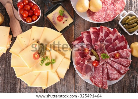 cheese, delicatessen and potato - stock photo