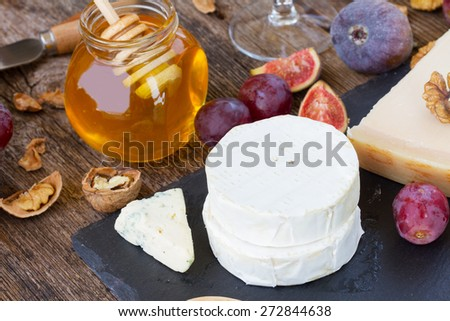 cheese dessert with honey, nuts and graoes - stock photo