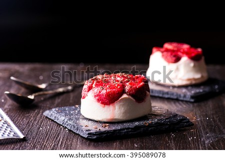 cheese dessert with strawberry on black wooden background - stock photo