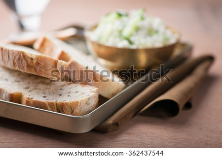 Cheese dip with cucumbers and bread slices. Selective focus. Copy Space - stock photo