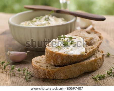 Cheese dip with olive oil and two bread slices. Selective focus - stock photo