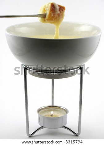 Cheese fondue in a small bowl over a tea light. - stock photo