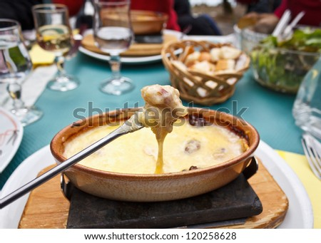 Cheese Fondue on a fork - stock photo