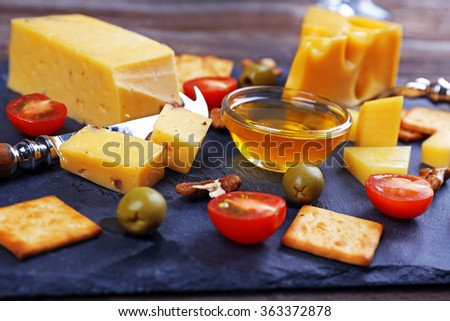 Cheese for tasting on a mat closeup