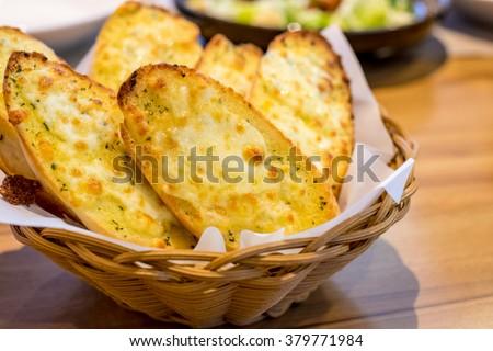 Cheese garlic bread in basket - stock photo