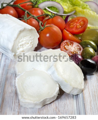 Cheese Goat with tomato cherry and olives