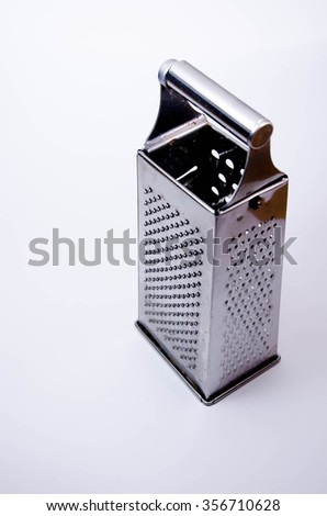 Cheese grater, red handle, grater isolated
