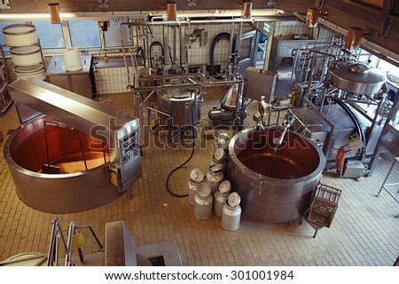 cheese making machine in modern dairy factory - stock photo