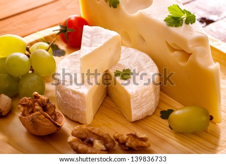 Cheese mix on wooden plate still-life