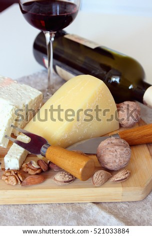Cheese, nuts and a glass of wine.